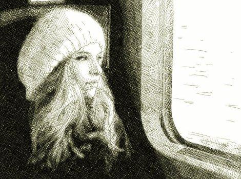 Une fille dans un train regarde par la fenêtre